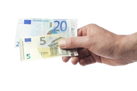 Male hand holding 5 and 20 Euro bill isolated on white Stock Photo
