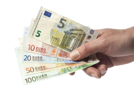 Hand with euro bills from 5 to 100 isolated on white. Including new 5 Euro bill issued in 2013. photo