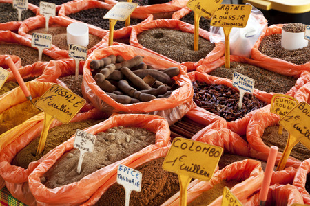 Market stand offering spices, grains and other food on Guadeloupe, French Antilles