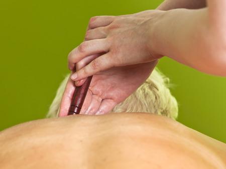 Close up of Massage therapist treating a woman Stock Photo