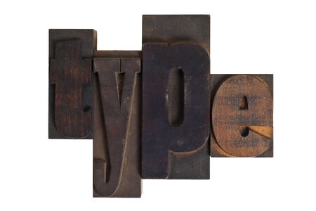 Word type in vintage wooden letterpress type, scratched and stained,  isolated on white background