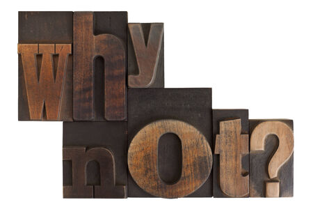 phrase why not? in vintage wooden letterpress type, scratched and stained, isolated on white background photo