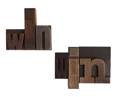 phrase win-win in vintage wooden letterpress type, scratched and stained, isolated on white background photo