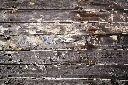 crumbling: Crumbling paint on wood grunge background