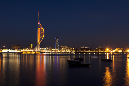 Waterfront of Portsmouth, England, with Spinnaker Tower and docklands at night