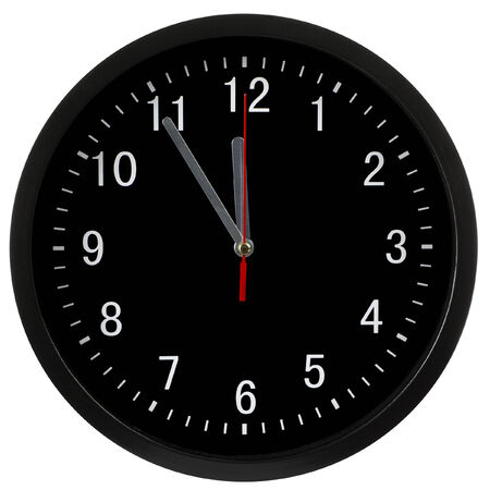 Black clock showing five minutes to midnight, isolated with clipping path