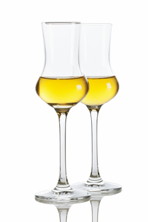 grappa: Two glasses of italian Grappa brandy isolated on white background Stock Photo