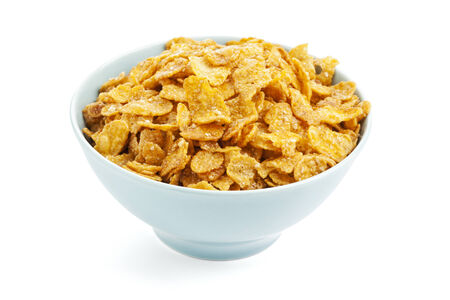corn flakes: Bowl of sweet corn flakes isolated on white background Stock Photo