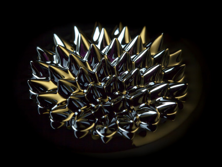 induced: Macro of Ferrofluid structure induced by a neodymium magnet reflecting golden and purple surface