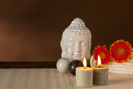qigong: Spa still-life with buddha head, Qigong balls, candles and flowers Stock Photo