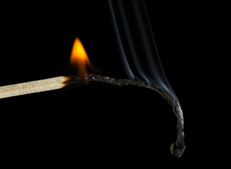 Closeup of burning match, burnout syndrome concept 写真素材