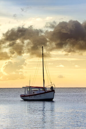 sint: Vintage fishing vessel in sunset, Sint Michiel, Curacao, Caribbean Sea
