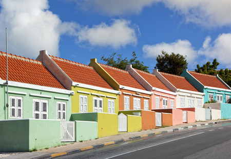 Row of houses painted in vibrant colors at Punda district of Willemstad, Curacao Stock Photo