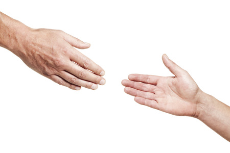 Two male hands reaching out for each other isolated on white