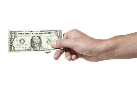 Male hand holding one dollar bill isolated on white background Foto de archivo