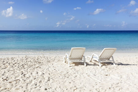 Two sunbeds at Curacao beach Stock Photo