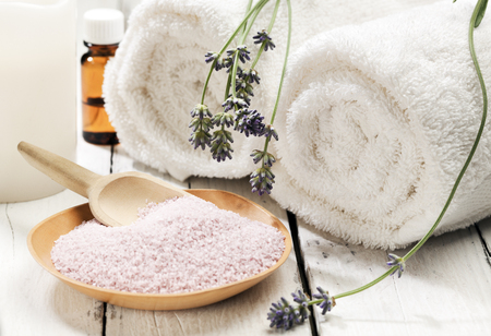 bath essence: Wooden Bowl of bath mineral with flowers towels candle and aromatic essence