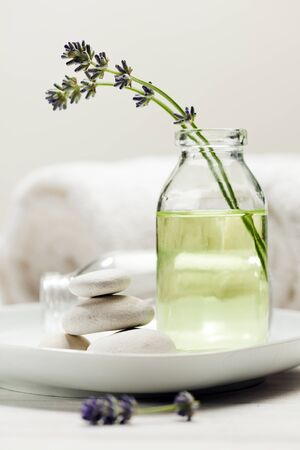 essence: Spa still life with lavender essence in bottle and pebbles Stock Photo