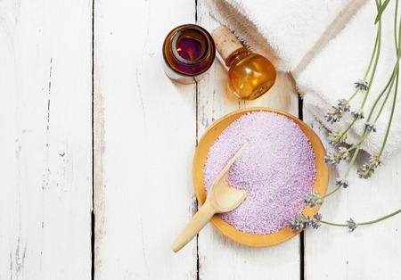 bath salt, apothecary bottle, towels and lavender twigs, top view, copy space