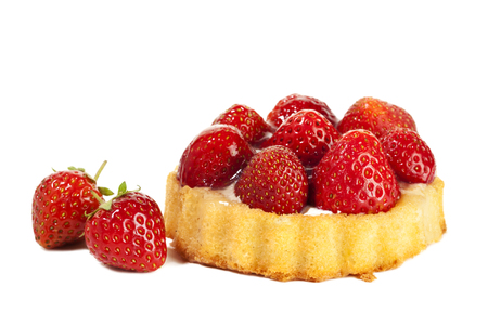 Strawberry tartlet and two fruits isolated on white background Stock Photo