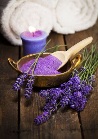 scented candle: Lavender bath salt in brass bowl, fresh flowers, scented candle and towels