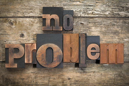 no problem: phrase no problem written with vintage letterpress printing blocks on rustic wood background