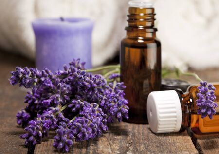 essences: Lavender flowers and bottles for aromatic essences