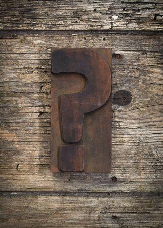 printing block block: question mark vintage letterpress printing block on rustic wood background
