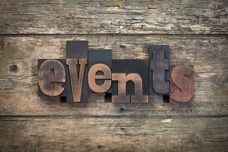 event: word events written with vintage letterpress printing blocks on rustic wood background Stock Photo