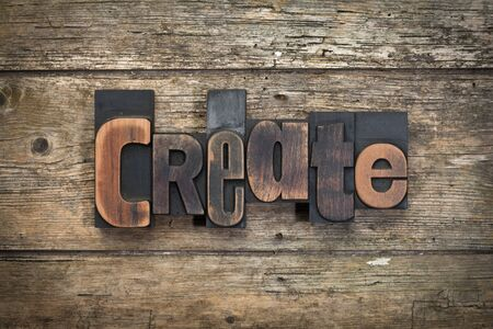 word create written with vintage letterpress printing blocks on rustic wood background Stock Photo
