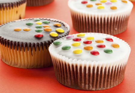 smarties: Cupcakes with white and dark chocolate icing and smarties