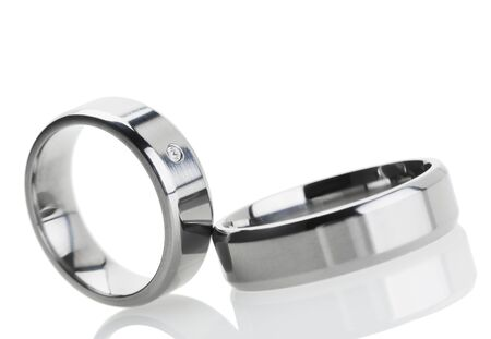 tilted view: Wedding rings reflecting on white background, tilted view