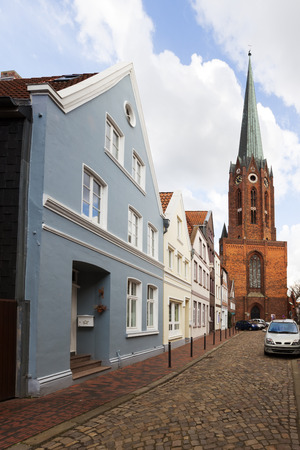 14th century: 14th century St.-Petri-Kirche church and historic facades at Buxtehude, Lower Saxony