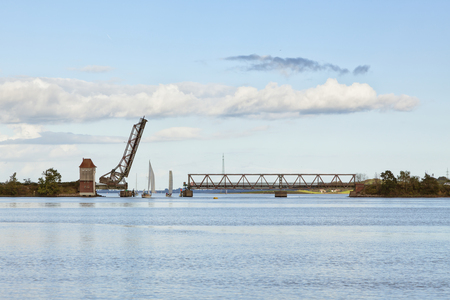 draw bridge: Historic draw bridge at Lindaunis across the Schlei inlet opened for passing sail boats