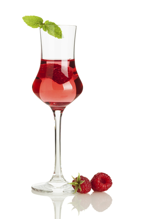 fruit of the spirit: Glass of raspberry liqueur with berries isolated on white background