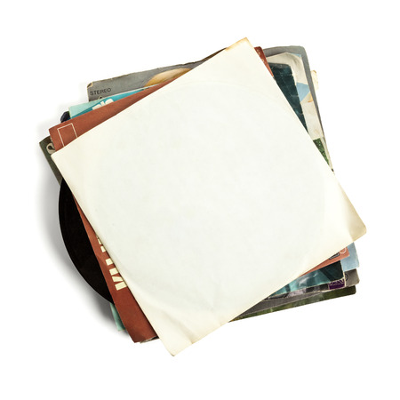 sleeve: Stack of old vinyl records, high angle view, top one with blank sleeve, isolated on white background