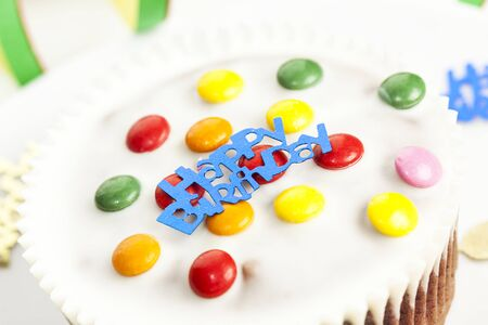 smarties: Happy Birthday written on a small cake with smarties