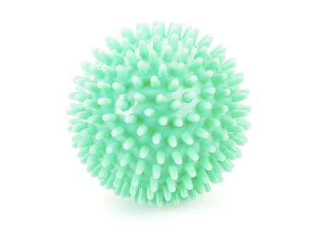 green massage ball isolated on white background