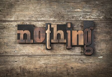 nothing: nothing, word written with vintage letterpress, type on wooden background Stock Photo