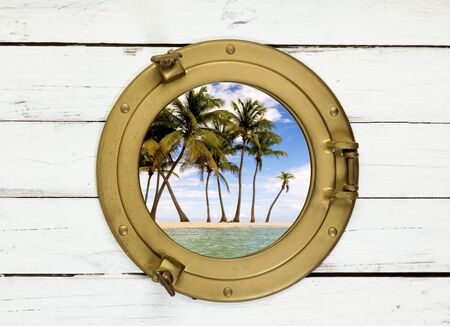 view through: Tropical island view through brass porthole in white wall