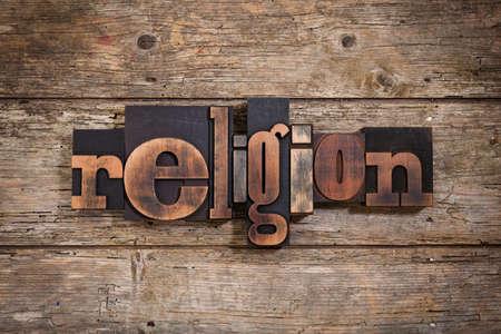 letterpress blocks: religion, single word set with vintage letterpress printing blocks on rustic wooden background Stock Photo
