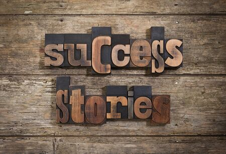 letterpress blocks: success stories, phrase set with vintage letterpress printing blocks on rustic wooden background