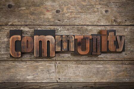 letterpress blocks: community, single word set with vintage letterpress printing blocks on rustic wooden background