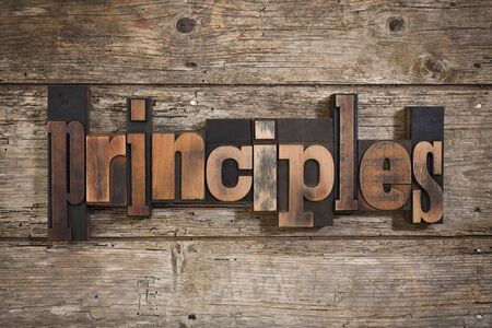 principles: principles, single word set with vintage letterpress printing blocks on rustic wooden background
