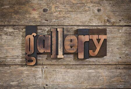 letterpress blocks: gallery, single word set with vintage letterpress printing blocks on rustic wooden background Stock Photo