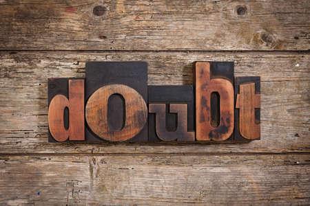 letterpress blocks: doubt, single word set with vintage letterpress printing blocks on rustic wooden background
