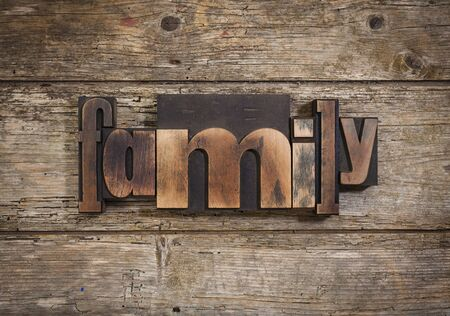 letterpress blocks: family, single word set with vintage letterpress printing blocks on rustic wooden background