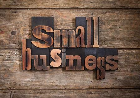 letterpress blocks: small business, phrase set with vintage letterpress printing blocks on rustic wooden background