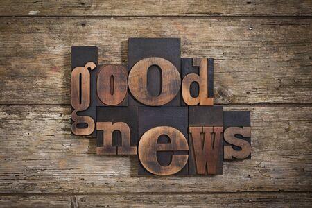 letterpress blocks: good news, phrase set with vintage letterpress printing blocks on rustic wooden background