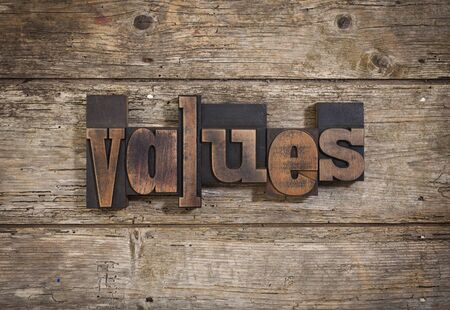 letterpress blocks: values, single word set with vintage letterpress printing blocks on rustic wooden background